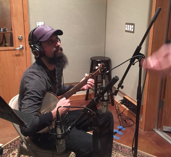 (Banjo time in Jed's booth)