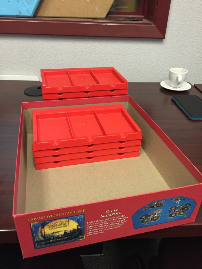 Stack of 4 card banks fits nicely inside a standard Catan box.