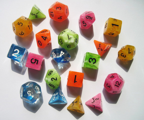 The super cool player dice for Floating Market in all five player colors - pink, blue, green, orange, and golden yellow.
