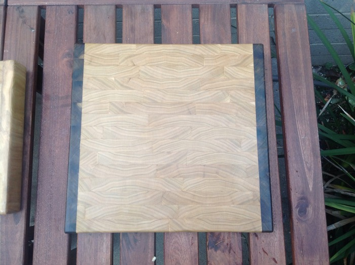 "1.5"" Thick 12X12 END GRAIN Poplar cutting board with dark green trim on two sides. This is a one off."