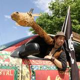 Nat__in_car__with_giraffe.medium