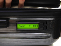 TUL: Suitcase with built-in weighing scale