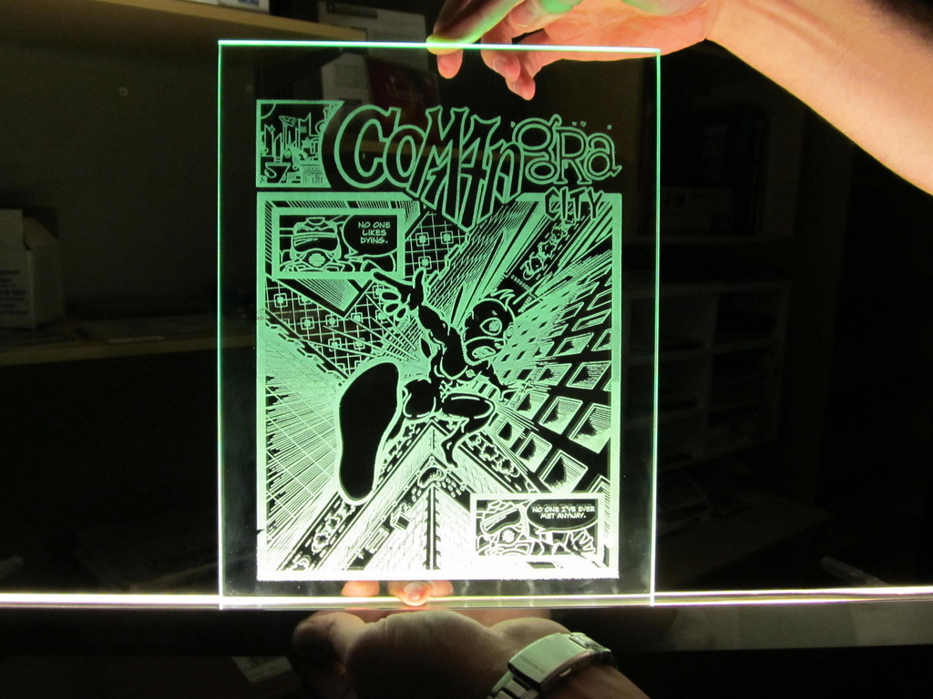 Comangra City: THE HUGE GLASS COMIC BOOK!'s video poster