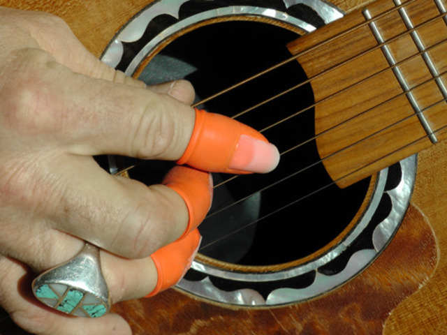 Classical guitar and thumb pick