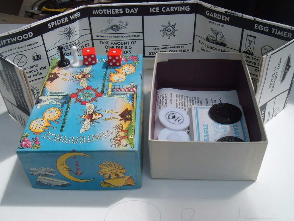 CENTERPIECE  small box holds a full sized board-game's video poster
