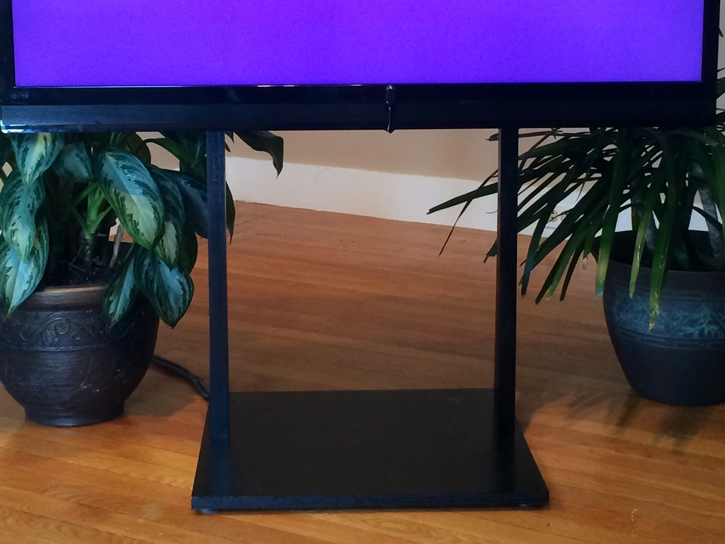 Tuckaway Stand - Hides your components behind your TV's video poster