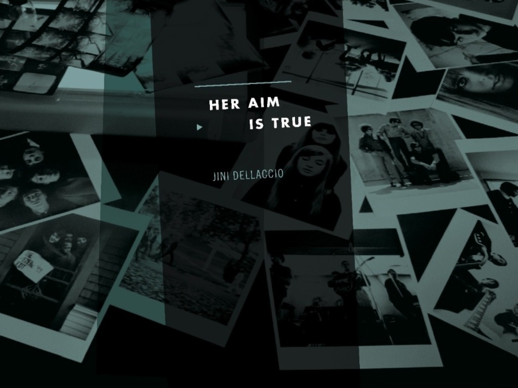 """HER AIM IS TRUE"" Unlikely rock photographer Jini Dellaccio's video poster"