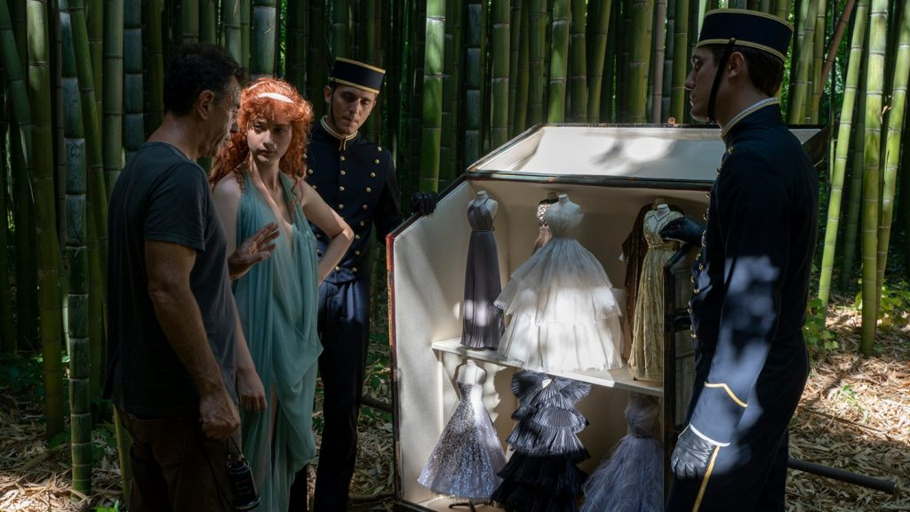 Director, Matteo Garron with miniature Dior dresses on set. Dior.com