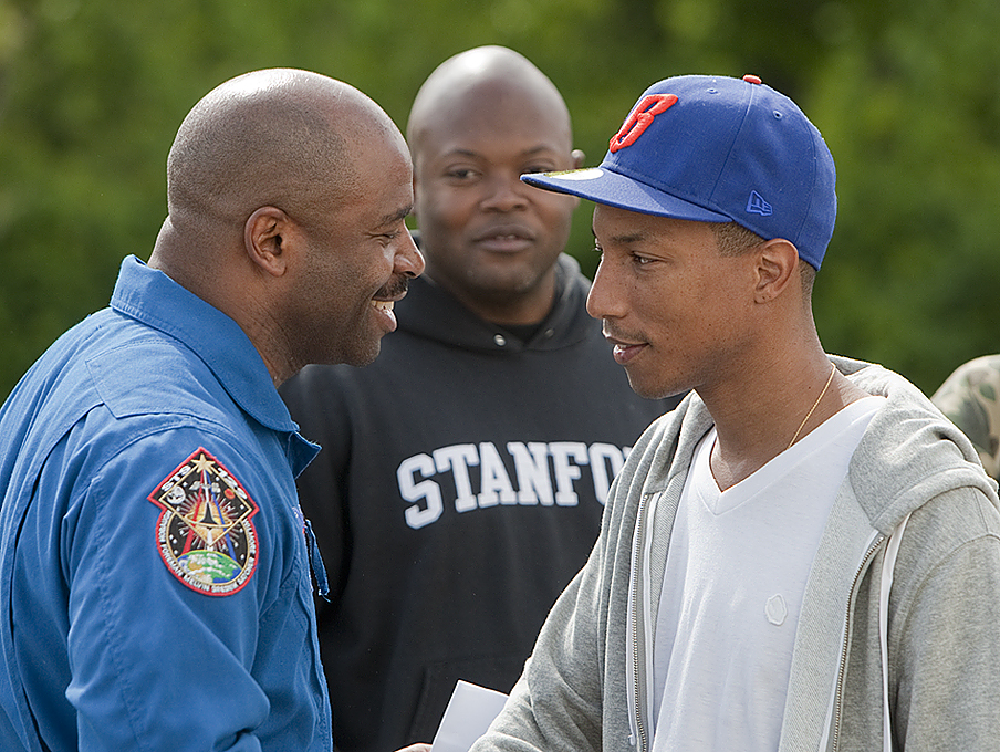 NASA's Associate Administrator for Education Leland Melvin and recording artist Pharrell Williams joined forces on April 23 in Virginia Beach, Va. to inspire and educate students about STEM (science, technology, engineering and math). Credit: NASA/Sean Smith.