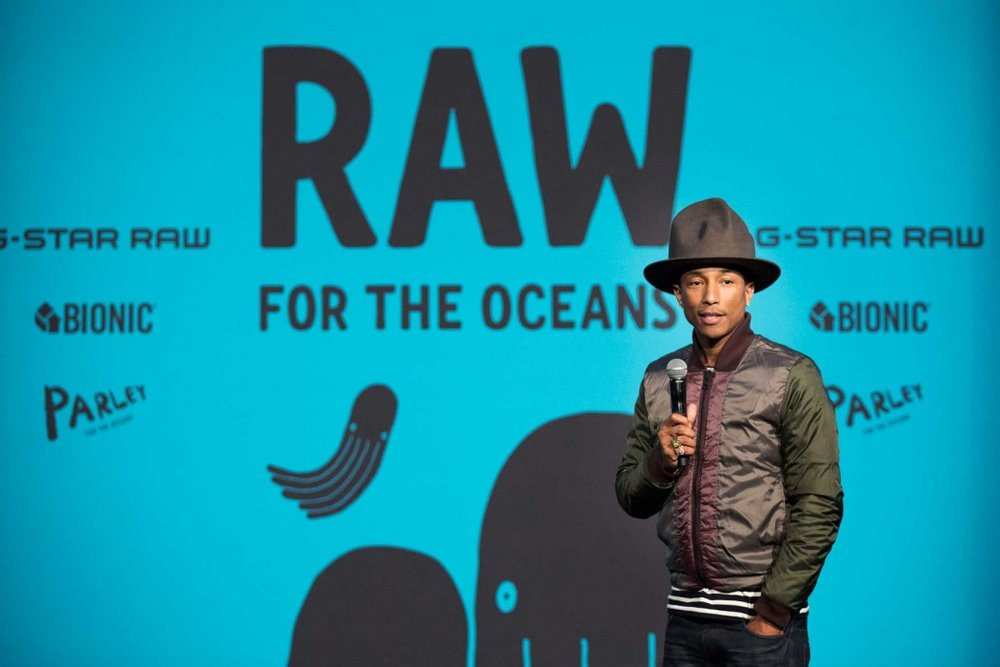 Recording Artist and Creative Director of Bionic Yarn Pharrell Williams speaks at an event to announce 'RAW for the Oceans', a long-term collaboration between Bionic Yarn and G-Star turning ocean plastic into Denim, at American Museum of Natural History on February 8, 2014, in New York City. MotMag.com