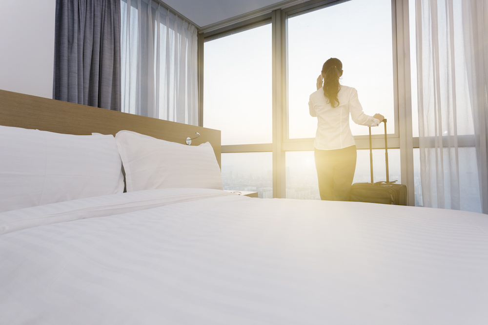Businesswoman in Hotel with Luggage small