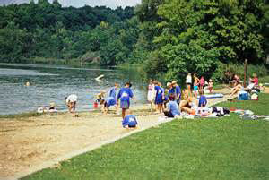 The sandmat creates a sandy play area between the lakefront water and the weeds and muck that lie on the lakefront shore.