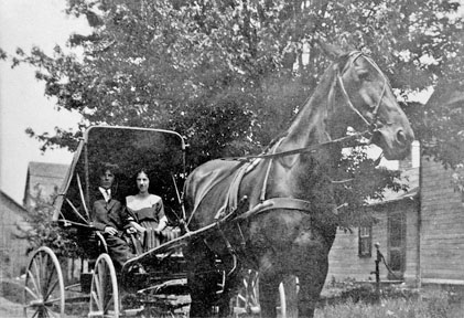 Couple in horse drawn buggy