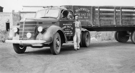 Bill Goldhawk beside Elarton Salt Works truck, c. 1945