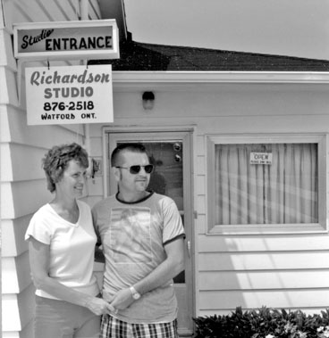 Gord and Jean Richardson in front of their studio, Watford, 1980