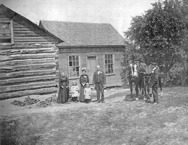 This settler's log cabin was home to the Benedict, Vaughn and Barnes families.