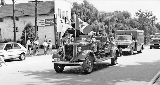 Warwick Firemen participating in parade through Warwick Village