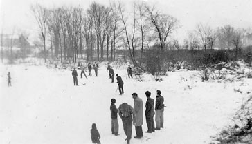 Boys playing hockey at outdoor rink, Warwick