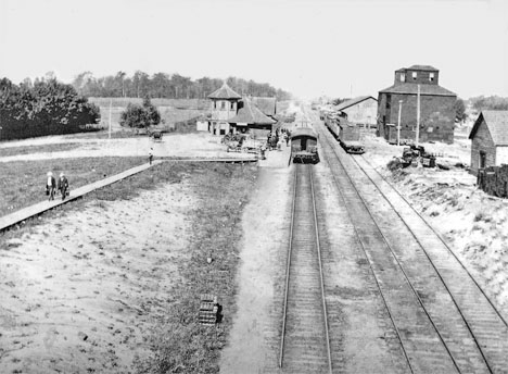 Railway tracks, facing west, Watford. The Dunlop Mill is across from the train station.
