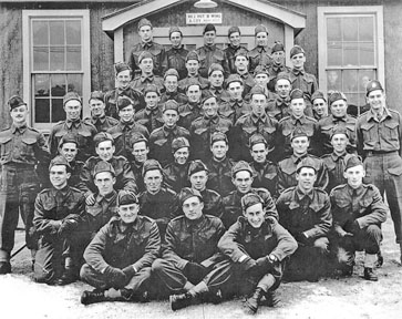 Wib Dunlop in military reserver: Wib is the middle person in the second row.