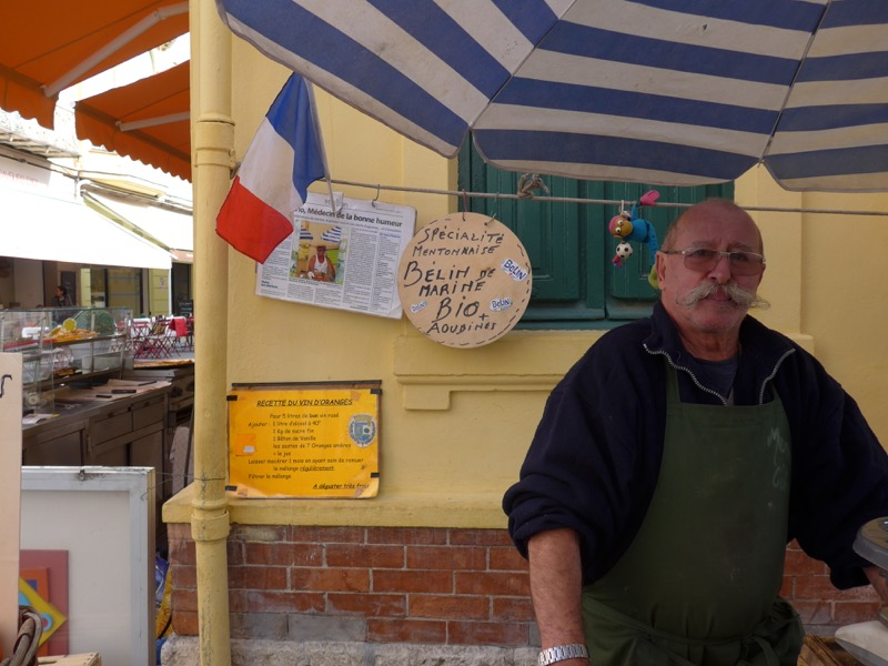 Local farmer selling produce on the market in Menton