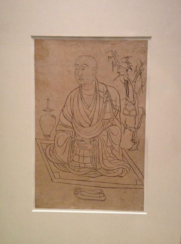 Buddhist monk having tea