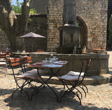 Deux Rocs: elevated Provencal village dining under centenary trees and live music of a burbling fountain