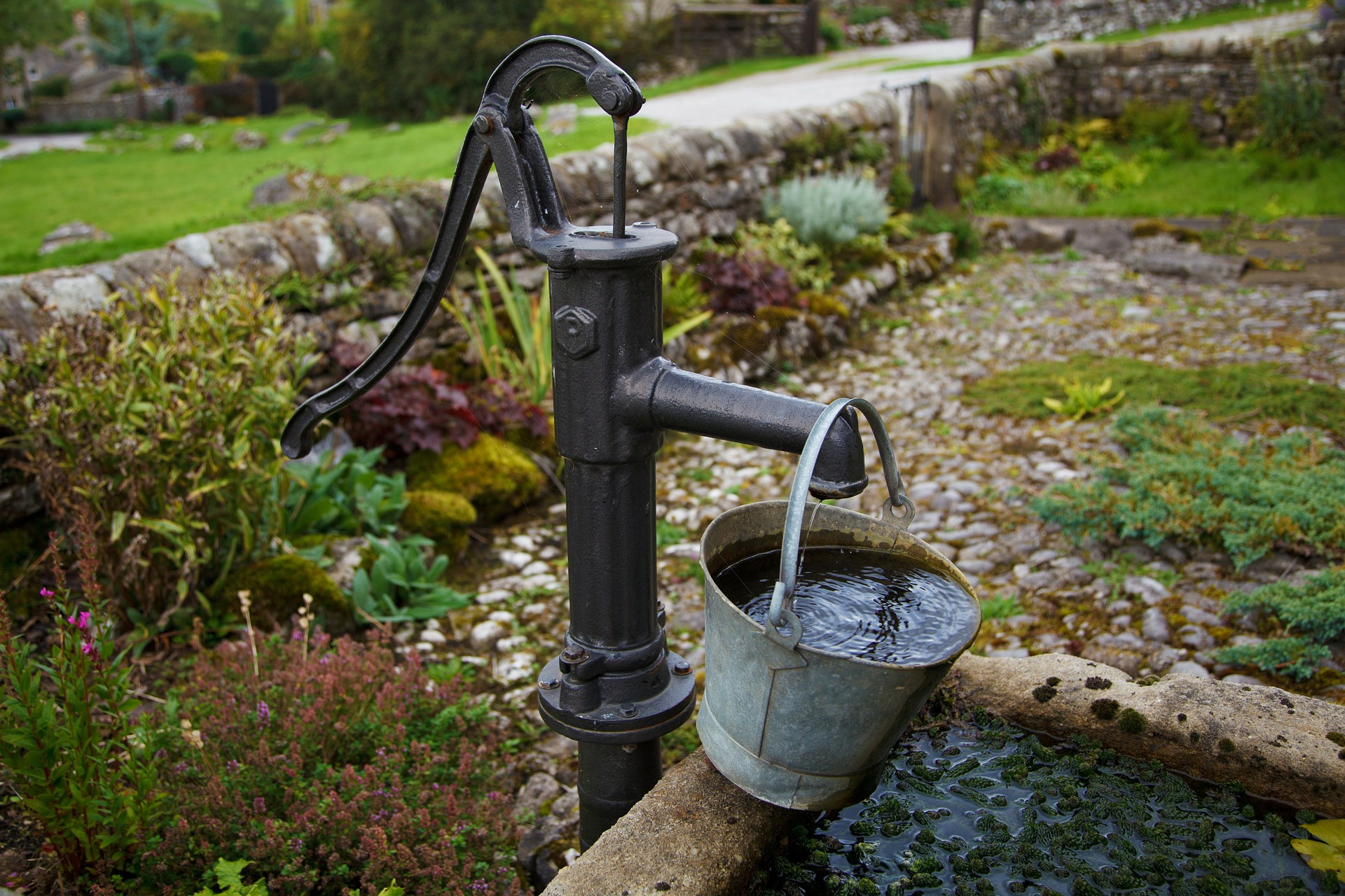 old fashioned water well and bucket