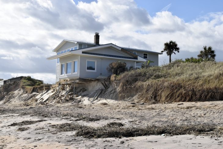 house on slope with erosion