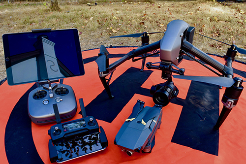 Two of Elias Grant's drones include a DJI Mavic Pro (small one) and a DJI Inspire 2.