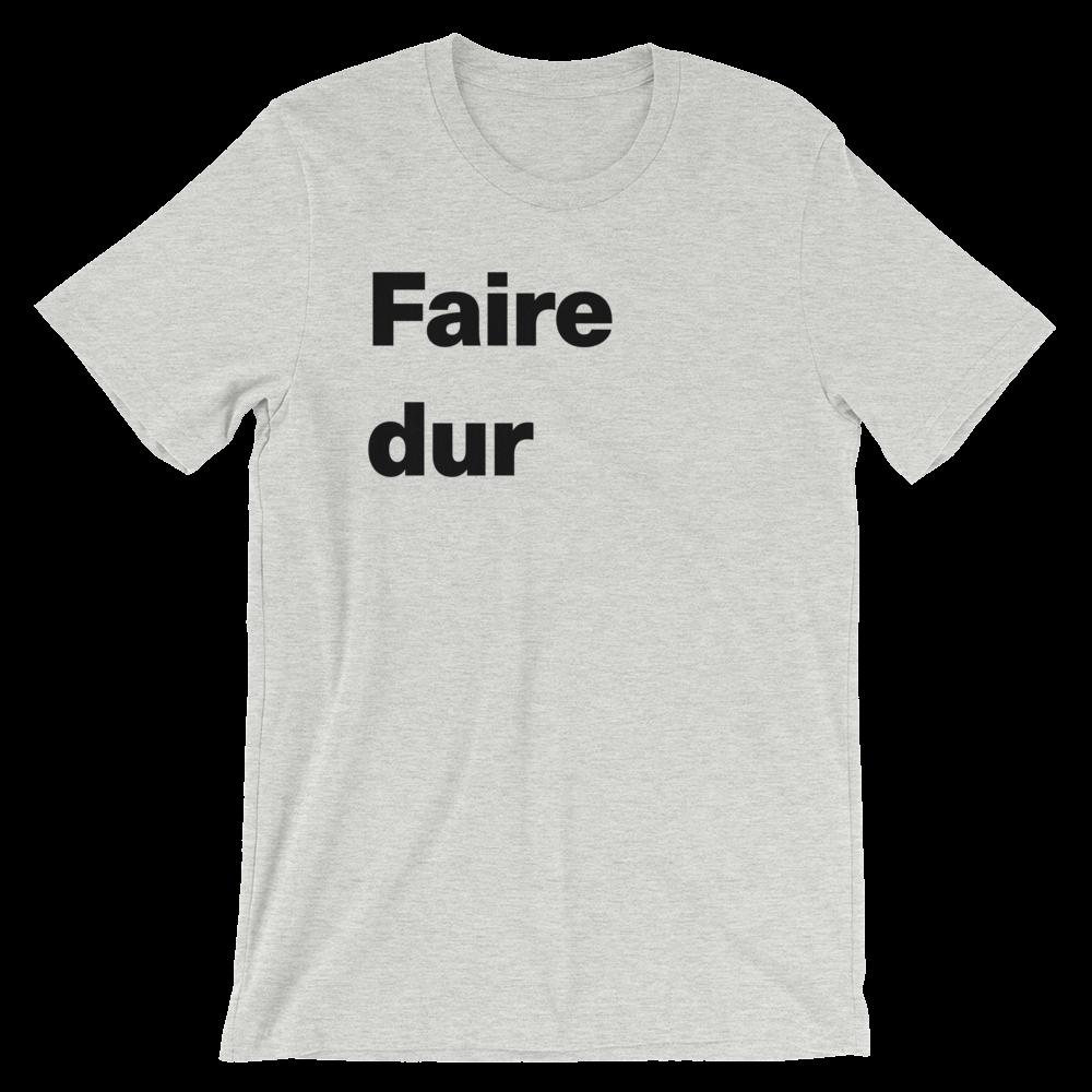 T-Shirt unisexe grisâtre «Faire dur»
