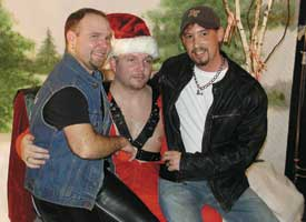 Rick Burgess (left) and Mark Christ (right) flank Leather Santa.