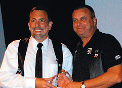 Steve Lenius (left) accepting award from Jon Krongaard. Photo by Bill Schlichting
