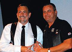 Steve Lenius (left) accepting award from Jon Krongaard. Photo by Bill Schlichting