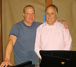 Tickles proprietors Joel Janssen (left) and Roy Caples by the grand piano. Photo by George Holdgrafer