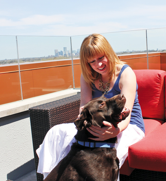 Kari Gray and Grizzly on the roof top deck. Photo by Todd Pernsteiner