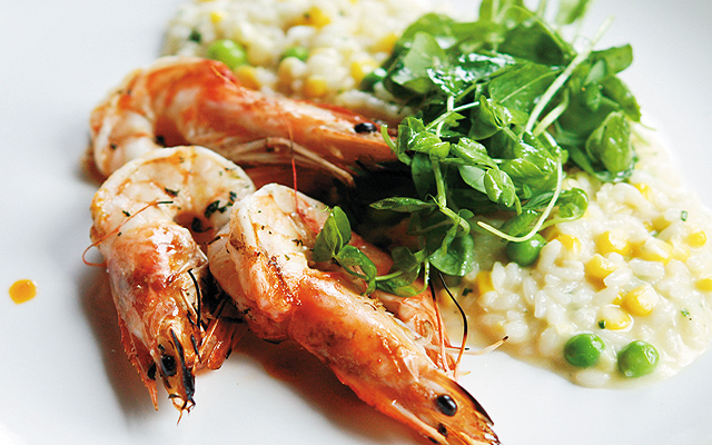 Shrimp with spring pea and corn risotto. Photo by Stephanie A. Meyer.