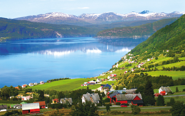 Norwegian village with a typical fjord in the background. Photo courtesy of iStockphoto