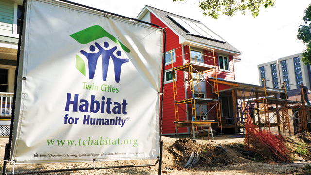 Habitat for Humanity volunteers finish work on a North Minneapolis home during Rainbow Build Week.