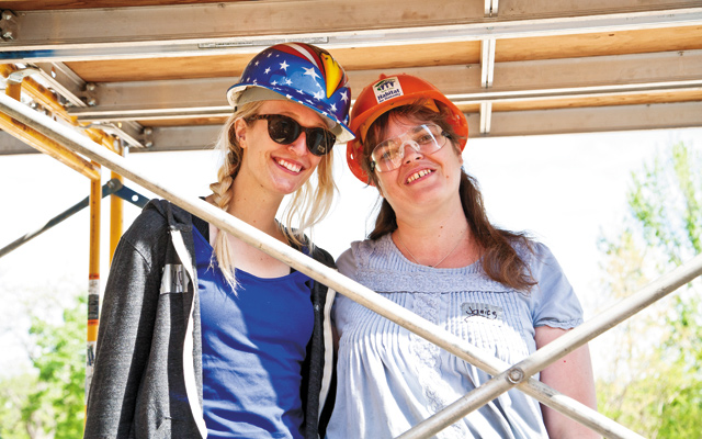 Janice Harmon (left), a future Habitat for Humanity homebuyer, and Kelly Berry (right), an AmeriCorps member who coordinated volunteers, posed for a photo during Rainbow Build Week.