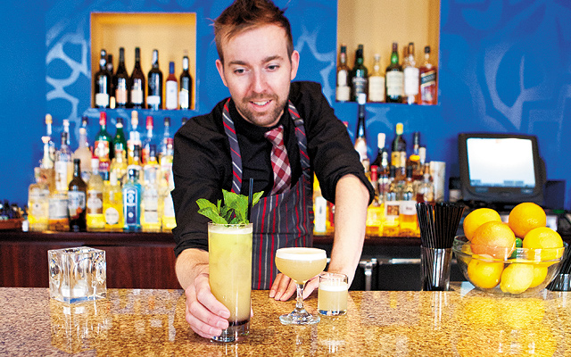 A tiki takedown called 1999 and The Bird Has Flown with aquavit, honey, tonic and more; Master bartender Robert Jones. Photo by Hubert Bonnet
