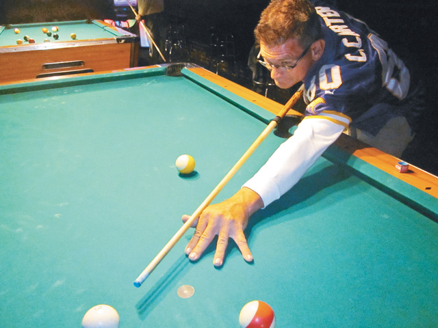 Pool tournament coordinator Jerry Schwartz cues a shot. Photo by George Holdgrafer