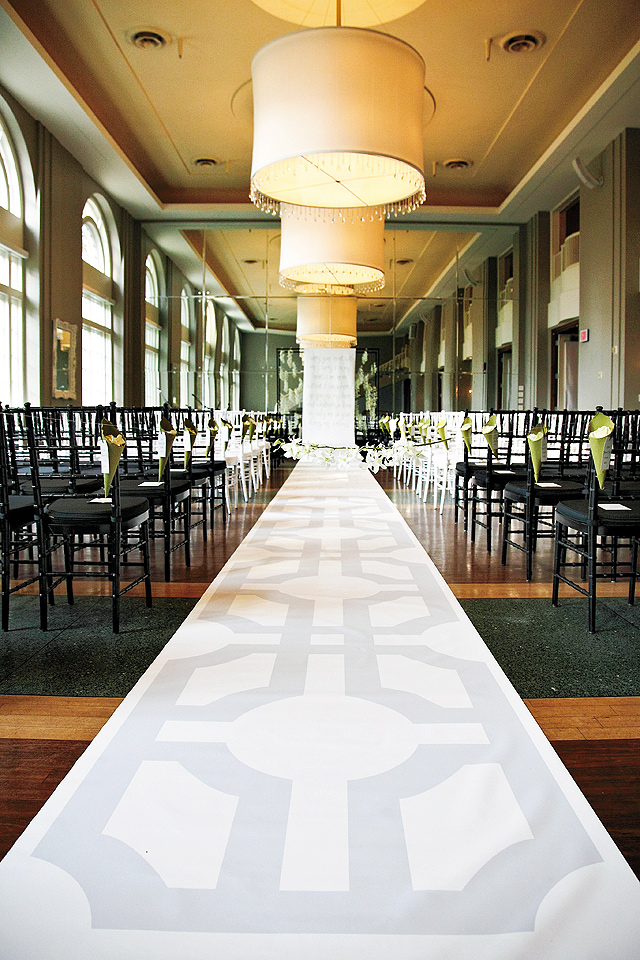 This beautifully branded, custom aisle runner tied in the wedding's linens and cake as well as the couple's favorite poem by e.e. cummings.