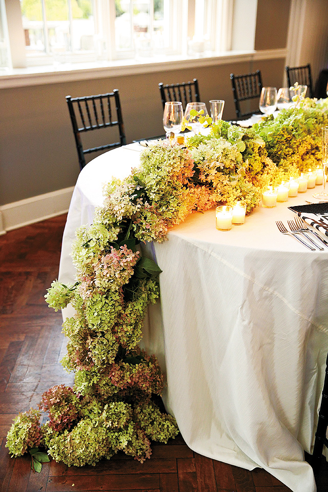 This hydrangea runner (designed by Martha's Gardens) surrounded by candlelight served as a stunning focal point in the room.
