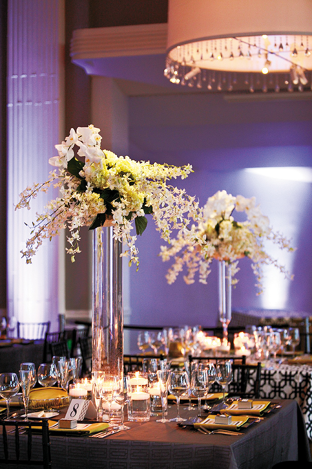 Pin spots on florals and custom uplighting on the walls by Level 11 drew attention to the centerpieces and enhanced the space.
