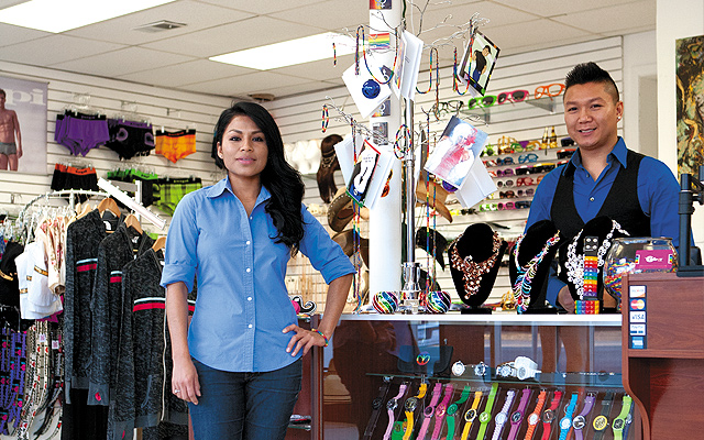 Merary Montes and Reagan Sirisavath surrounded by their diverse and growing inventory of GLBT-oriented products. Photo by Mike Hnida