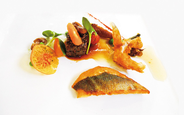 Loup de Mer 2 ways, ribeye, mandarin orange, orange candy chip, chili powder. Photo by Austin Lindstrom