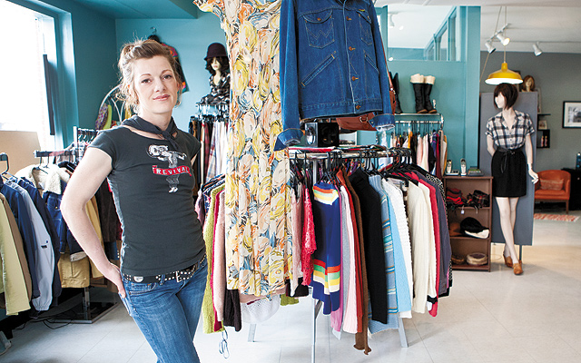 Chelsea Goodale stands in front of two of her favorite pieces: a 1940s dress and a vintage Wrangler jean jacket. (At right) The aesthetic of Shag's hair salon matches the feel of the vintage clothing boutique. Photo by Hubert Bonnet