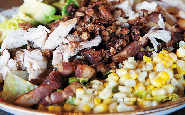 A Southern twist on a Cobb salad which has corn, Honeycrisp apples, hand-cut Applewood-smoked bacon, poached chicken breast, and is topped with BBQ ranch dressing.