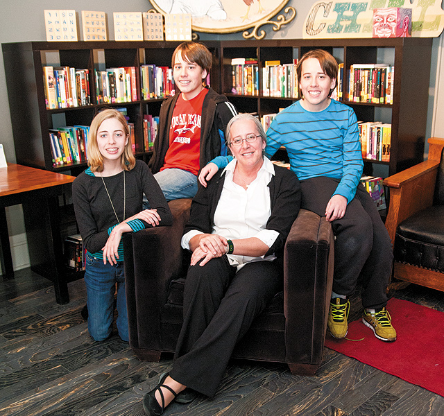 Betsy and her kids, where they most like to spend their time: the Library area. Photo by Brett Dorrian